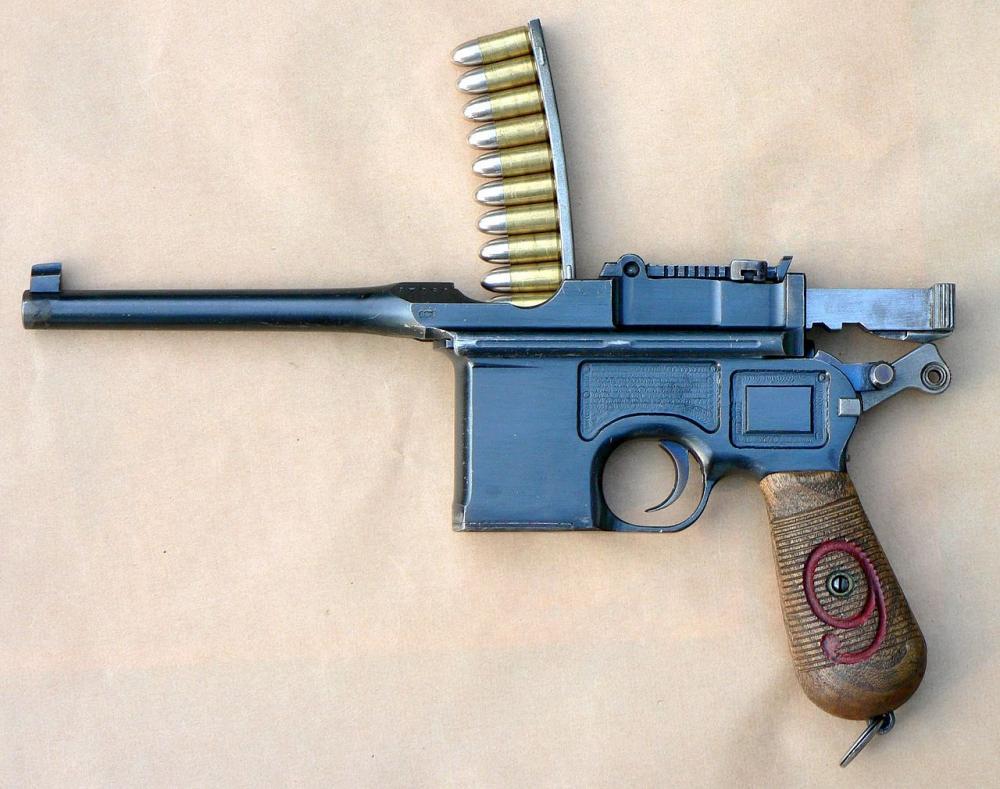 Mauser_C96_Reloading.thumb.JPG.4b2d61ebc780bb772f204ed3b7d6b424.JPG