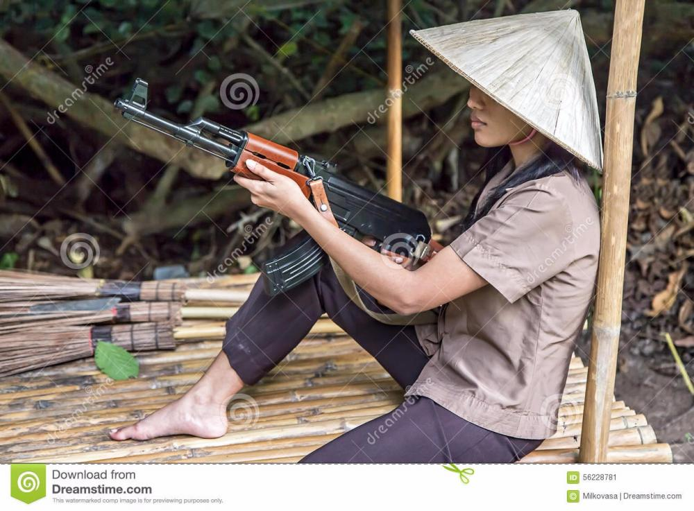 woman-machine-gun-sits-bamboo-sh.thumb.jpg.91faf5eb506beeb84c958de8e70b532b.jpg